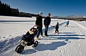 Family having a walk in snow, Styria, Austria