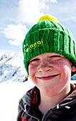 Boy smiling at camera, Planai, Schladming, Styria, Austria