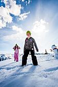 Two children in snow, Planai, Schladming, Styria, Austria