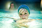 Young woman wearing a knit cap in thermal bath, Bad Radkersburg, Styria, Austria