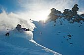 Skier downhill skiing in deep snow, Hintertux Glacier, Zillertal, Tyrol, Austria