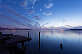 A pier in the lights of a sunset, Trasimeno lake, Umbria