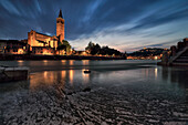 Sant'Anastasia in Verona reflect, during blue hour, into Adige River.