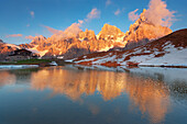 Pale di San Martino and a little lake, in a summer's sunset, Dolomites