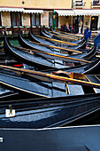 Venetian gondolas parked in a canal in Venice