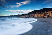The fisherman village near at the sea in Varigotti town, La Spezia, Liguria, Italy. Beautiful vision of the waves near the house in the beach