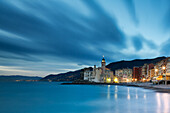 The last lights of the evening over Camogli town, in the cinque Terre site, Liguria, Italy . Panoramic from the beach with sea view .