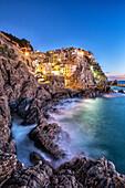 The lights of Manarola at the blue hour, Cinque Terre National Park, Liguria, Italy.