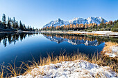 The reflection of mounts Braccia and Senevedo in the Lake Entova in the autumn season, Valmalenco, Sondrio, Lombardy, Italy