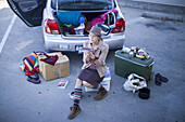 Day 300 and counting. While seated amidst her belongings at the trunk of her car, aspiring actress Jodi Elliott applies make up before an audition. Elliott has spent the last 10 months living out of her car. She house sits, couch surfs and has managed to