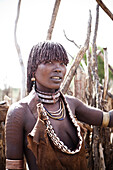 HAMER VILLAGE, OMO VALLEY, ETHIOPIA. A portrait of a young woman in the Hamer Village in the remote Omo Valley of Ethiopia.
