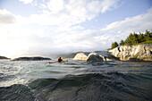 Dutch born, Rogier van Oorschot  founder of Norway-AdvenTURes , kayaks on the waters off of Kalvag, Norway.