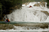 Clay Wright waits for Nick Troutman to make it down a set of slides in Agua Azul, Mexico.