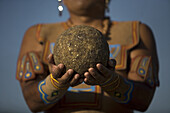 A Mayan ball player holds up the ball made of hule, natural rubber, in Chapab village in Yucatan state in Mexico's Yucatan peninsula, June 14, 2009.