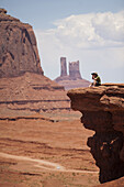 Tourists enjoy the views at John Ford's Point at Monument Valley Navajo Tribal Park in southern Utah. The park, operated by the tribe, was once a popular set for western films of the 1930s through 60s. It is immensely popular among European tourists.