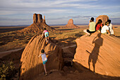 Tourists climb atop rocks photographed by Ansel Adams at Monument Valley Navajo Tribal Park in southern Utah. The park, operated by the tribe, was once a popular set for western films of the 1930s through 60s. It is immensely popular among European touris