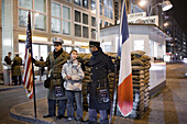Checkpoint Charlie  Tourists pay 1 Euro per photo to pose with actors dressed as Allied soldiers and military police.  Berlin, October 2008