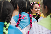 Performers sit and laugh in the bleachers at the Guelaguetza Auditorium on Cerro del Fortin in Oaxaca City, Oaxaca state, Mexico on July 21, 2008. The Guelaguetza is an annual folk dance festival - dancers from all corners of the state gather in celebrati