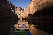 Paddling on the Colorado River below the Glen Canyon Dam. The 17-mile stretch of canyon between the dam and Lee's Ferry, where boats trips start the ten-day run through the Grand Canyon, is a low-traffic spot for two-day float trips on canoe, kayak or raf
