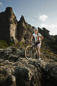 Mexican cyclist Daniela Campuzano rides her bike uphill on a rocky place during a mountainbike session in Hidalgo, Mexico.