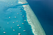 Aerial view of live aboard charter vessels moored in a lagoon, Hulhule Island, Male' Kaafu, Atoll, Maldives, on the 5 November 2006.
