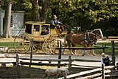 A living museum recreating colonial life in New England, Old Sturbridge Village in Sturbridge, features an authentic stagecoach from the period which visitors can ride..