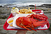 The Lobster Shack at Two Lights is a popular place to get lobster and other seafood dinners on the coast of Maine in Cape Elizabeth.