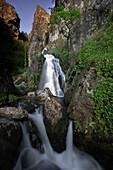 Waterfall and Beredo oak forest,  Campesinho River,  Peneda-Geres National Park,  Portugal.