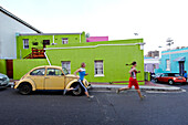 Katrin Schneider and Susann Scheller running trough the streets of the very colorful Bo-Kaap or Capa Malay Quarter of Cape Town. South Africa.