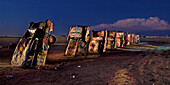 'West of Amarillo, Texas is this public art display called The Cadillac Ranch on I-40. It was created in 1974 by Chip Lord, Hudson Marquez and Doug Michels, who were a part of the art group Ant Farm, and it consists of what were when originally installed