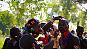 The Maza, the ones who will whip the women are a group of men who have already leapt across the cattle, and live apart from the rest of the tribe, moving from ceremony to ceremony.   Bull Jumping Ceremony, Omo valley, Dimeka,Ethiopia, 2010.
