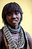Hamar are known for practice of body adornment and roll their locks with fat and red ochre assile, and than twist them into crimson-colored dreads called Goscha, a style that men find attractive.  Dimeka, Omo Valley, Ethiopia, 2010