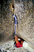 Rock climber Bob Porter makes his way up Zodiac, a 16 pitch 5.11 A3+ aid route on El Capitan in Yosemite National Park, California.