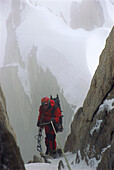 Conrad Anker, a world renown climber, rappels down the side of a K7 in stormy weather. Karakoram, Pakistan. Conrad spent 10 days battling the weather during his attempt to climb K7.