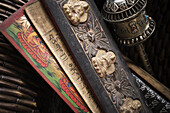 Close-up of Tibetan prayer holders and a prayer wheel.  Ron Koeberer / Aurora Photos