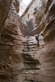 Josh Williams rappelling down the North Fork of Robbers Roost Canyon, Robbers Roost Country, Utah.  Whit Richardson / Aurora Photos