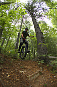 Adam Masters rides his mountain unicycle around Lake Powhatan in the Bent Creek Experimental Forest near Asheville, NC.