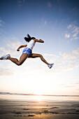 A woman runs in athletic gear in Oceanside, California. releasecode: 20070201
