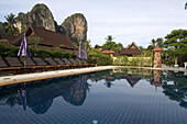 Views of the Thaiwant Wall, a famous climbing destination in Railay, from one of the the pools of the Railay Bay Resort and Spa, a newly remodeled resort catering to the wealthier crowd.