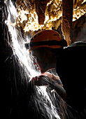 Cave explorer Mark Wright leans into an underground stream of water to quench his thirst in Moon Cave in Mulu National Park in Sarawak Borneo, February 2, 2007. Mark Wright was part of a group of British explorers that mapped an additional 26 kilometers o
