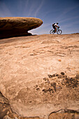 An unknown racer rides by during the mountain biking leg of day five of the 2006 Primal Quest adventure race in Moab, Utah.  It was the largest expedition adventure race ever held with 95 co-ed teams of four covering 400 miles in 5-10 days in hopes of win