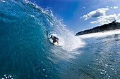 Jack Johnson surfing at Rocky point, north shore, Oahu, Hawaii
