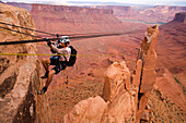 An unknown racer crossing a Tyrolean Traverse during the ropes leg of day eight of the 2006 Primal Quest adventure race in Moab, Utah.  It was the largest expedition adventure race ever held with 95 co-ed teams of four covering 400 miles in 5-10 days in h
