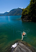 Ben Sanders takes a swim during a wilderness vacation in Lago Yelcho, Chile.