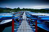 LANGKAWI, MALAYSIA - JUNE 22, 2007: Boats sit idle at the Tanjung Rhu jetty. photo by Ian Shive/Aurora