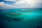 Aerial view of Allligator Reef Light and surround waters.  Underwater topography reflects the spur and groove coral formations common throughout the Florida Keys