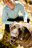 Tina Sommer and  her dog Roxy take a break while trail running on the trails near Santa Fe, New Mexico in the fall season.