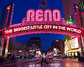 'Glittering icon archway advertising ''''Reno - The Biggest Little City In the World'' at night, leading into the casino quarter in Reno, NV.'