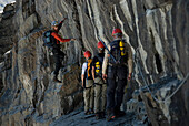 A group of climbers including is guided through some steep terrain in the Canadian Rockies, British Columbia, Canada.