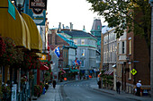 People walk along the Rue St. Louis in Old Quebec, a World Heritage Site in Quebec, Canada.
